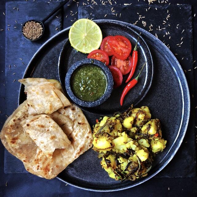 Paratha with zeera aloo, chutney and salad