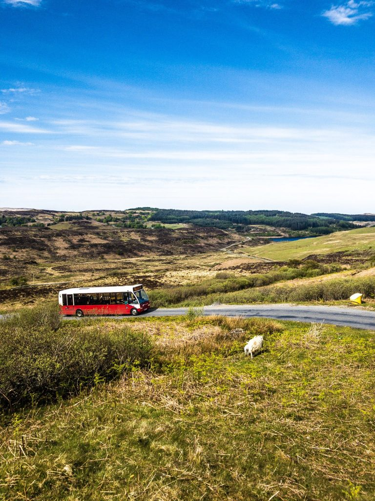 Bus driving up a hill in Isle of Mull