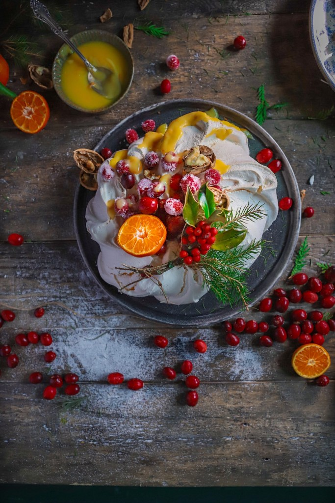meringue with orange curd and sugared cranberries